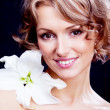 Woman with a lily — Stock Photo