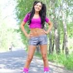 Woman on roller skates — Stock Photo