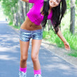 Stock Photo: Woman on roller skates