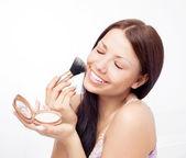 Woman applying powder — Stock Photo
