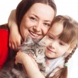 Family with a cat — Stock Photo