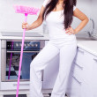 Housewife with a broom — Stock Photo