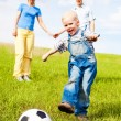 Family playing football — Stock Photo