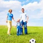 Family playing football — Stock Photo