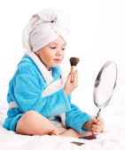Child with a mirror and a brush — Stock Photo