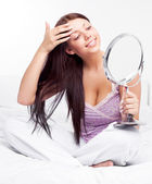Woman with a mirror — Stock Photo