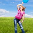 Girl with balloons - Stockfoto