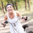 Woman riding a bicycle — Stock Photo #5845121