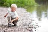 Boy near the river — Stock Photo