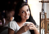 Girl with a cup of tea — Stock Photo