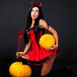 Imp with pumpkins — Stock Photo #6694654