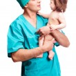 Surgeon with a baby — Stock Photo