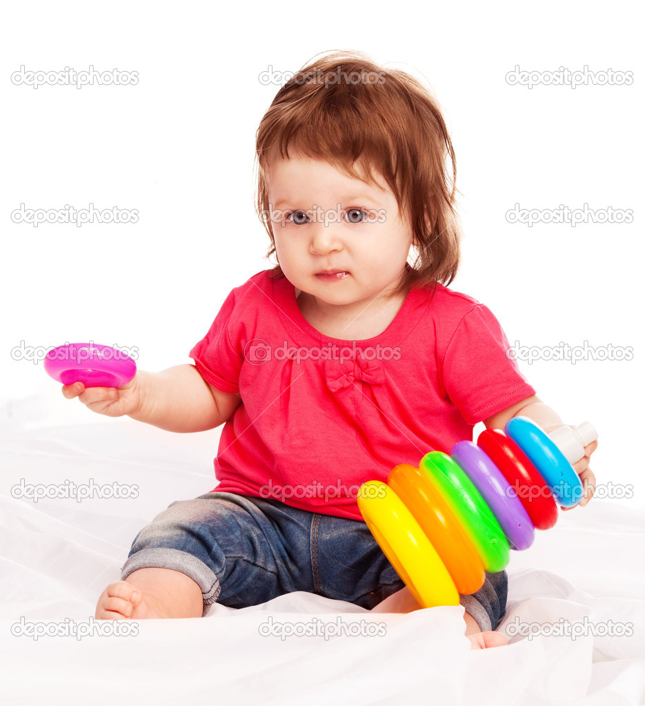 Cute baby playing with toys and making a pyramid on the floor — Stock Photo #6726891