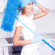 Housewife with a mop - Stockfoto