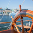 Ship helm and a view on Stockholm, Sweden - Stock Photo