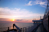 Ship deck view, ocean at sunset — Stock Photo