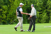 Two Golfers shake hands at Country Club — Stock Photo