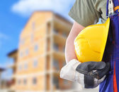 Worker with blurred construction in background — Stock Photo