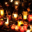 Stock Photo: Candle flames illuminatingduring night of All Saint's Day