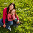 Mother and daughter on a grass — Stock Photo #5862274