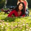 Mother and daughter on a grass — Stock Photo