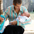 Everyday problems. The father with the newborn son in park — Stock Photo