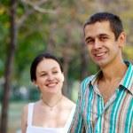 Lovely couple in autumn park — Stock Photo