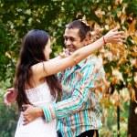 Happy couple in autumn park — Stock Photo