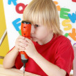 Stock Photo: Little boy on creative lesson