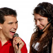 Royalty-Free Stock Photo: Couple singing karaoke isolated on white background