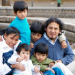 Стоковое фото: Latin family sitting in the street