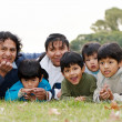 Happy Latin family in the park — Stock Photo