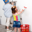 Small children washing a wall — Stock Photo