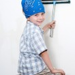 The little boy washing a wall — Stock Photo