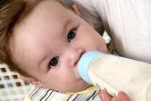 Portrait baby drinking milk of her bottle — Stock Photo