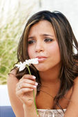 Portrait of the lonely crying girl with a flower — Stock Photo