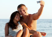 Closeup portrait of happy couple enjoying vacations — Stock Photo