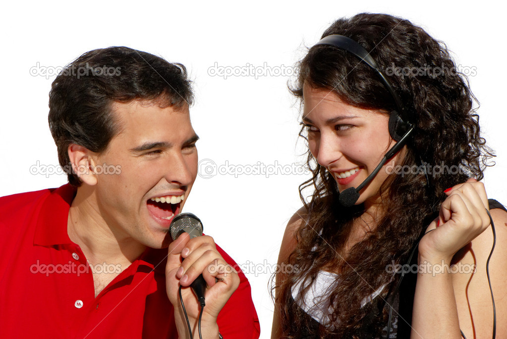 Couple singing karaoke isolated on white background — Stock Photo #6172312