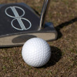 Golf ball and a putter — Stock Photo