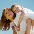 The mother with small son against sky — Stock Photo