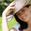 The beautiful Colombian girl in a hat — Stock Photo
