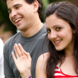 Portrait young happy teenage girl at the park with friends — Stock Photo #6377902