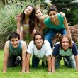 Happy group of friends outdoors in a park — Stock Photo