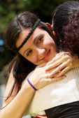 Portrait of happy daughter in embraces of a mother — Stock Photo