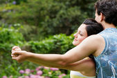 Happy couple holding each other by hands — Stock Photo