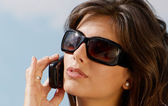 Portrait of the girl in sunglasses and mobile phone — Stock Photo