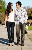 Happy young couple walking at park — Stock Photo