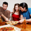 The cheerful company of youth eating a pizza — Stock Photo #6387893