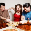 The cheerful company of youth eating a pizza — Stock Photo #6387946