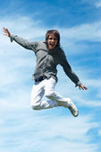 Happy guy jumping — Stock Photo